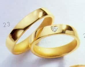 Trouwringen geel goud met schitterende briljant