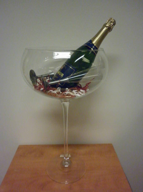 Coupe met champagnefles dankgeschenk