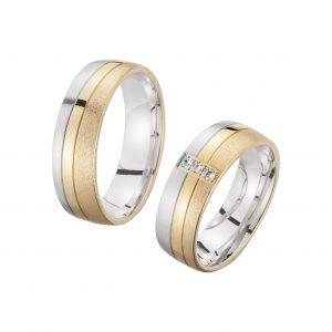 Trouwringen Wit Geel Goud met enkele Diamant Sieger